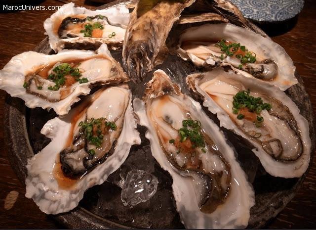 Huîtres à la sauce soja épicée, fines herbes et concombre